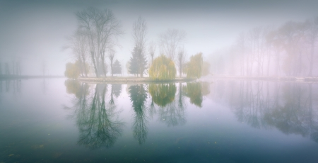 Foggy morning panorama in the autumn park near the lake photo