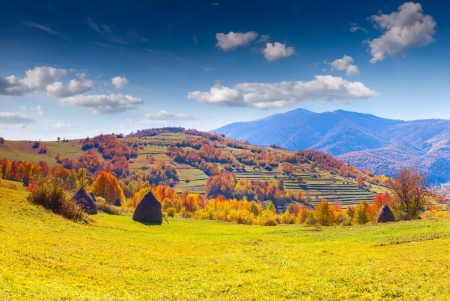 Colorful autumn panorama of the mountain village photo
