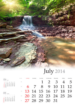 2014 Calendar. July. Beautiful summer landscape in the forest with waterfall. photo