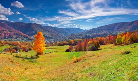 Colorful autumn panorama of the mountain village photo