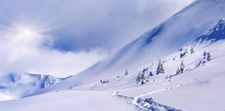 Panorama of the snowy mountain. Snowstorm photo