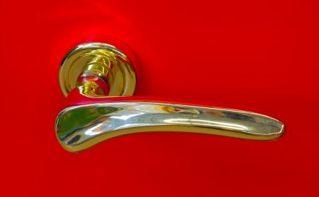 golden door handle on a red  photo