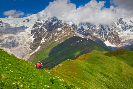 Photographer takes pictures in the mountains  The main Caucasian ridge  Svaneti, Georgia   photo