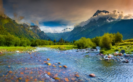 Fantastic landscape with a blue river in the mountains. Upper Svaneti, Georgia, Europe. Caucasus mountains. Stock Photo