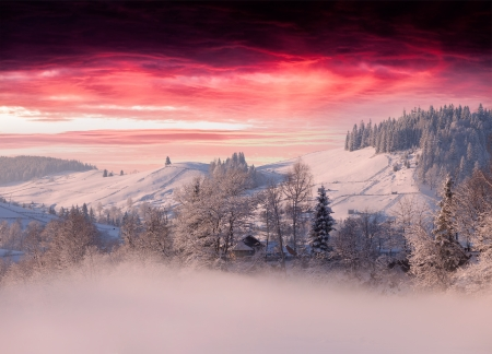 ander:  Foggy winter landscape in mountain village ander the dark red sky Stock Photo