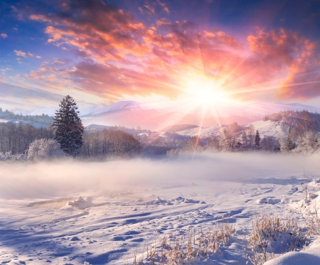 Beautiful winter sunrise in the mountain village. photo