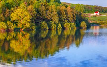 vibrant cottage: Colorful spring landscape on the lake