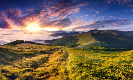 dramatic sunrise: Beautiful summer landscape in the mountains. Sunrise Stock Photo