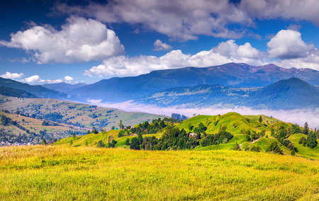 Beautiful summer landscape in the mountains village photo