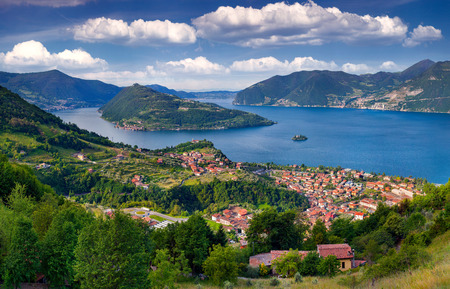 View of the city Marone, a bright sunny day. Italy, the Alps, Lake Iseo. 免版税图像