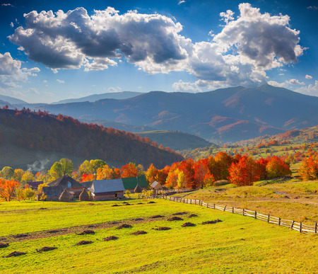 Colorful autumn landscape in the mountain village photo