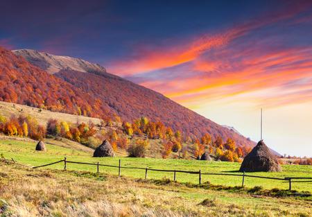 Colorful autumn sunrise in the mountain village photo