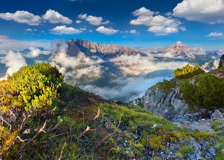 Gruppo Del Cristallo mountain range at foggy summer morning. Dolomites mountains, Italy, Europe. photo