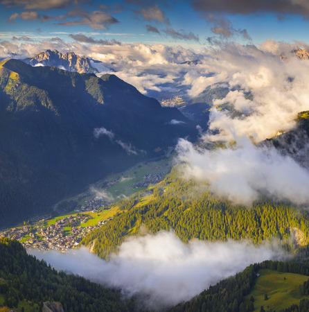 fassa: Campitello Di Fassa anf Folla Di Fassa villages in the morning mist. Dolomitos mountains, Alps, Euripe. Stock Photo