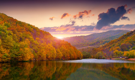 autumn sky: Colorful autumn landscape in the mountain lake