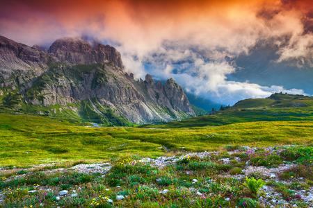 Colorful summer sunrise in Italy Alps, Tre Cime Di Lavaredo, Dolomites, Europe. photo