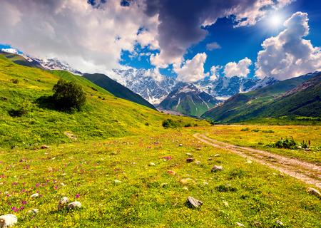 ushguli: The main Caucasian ridge, Shkhara mountain. The view from the Ushguli village. Georgia, Upper Svaneti Stock Photo