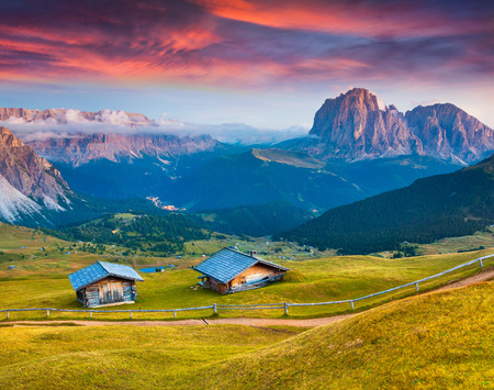 selva: Dramatic sunrise on the Sassolungo (Langkofel) and Sella group, valley Gardena. National Park Dolomites, South Tyrol. Location Ortisei, S. Cristina and Selva, Italy, Europe.