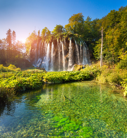 southeast europe: Landscape of a beautiful rock with a waterfall under the blue sky. Plitvice Lakes National Park is the oldest national park in Southeast Europe and the largest national park in Croatia.