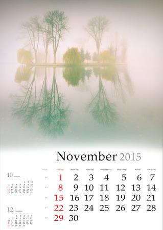 2015 Calendar. November. Beautiful autumn landscape on the lake