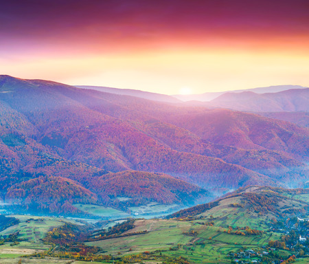 Colorful autumn sunset in the mountains. photo