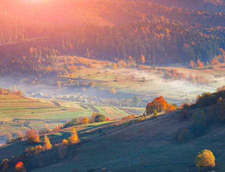 Foggy autumn morning; in the mountain village. photo