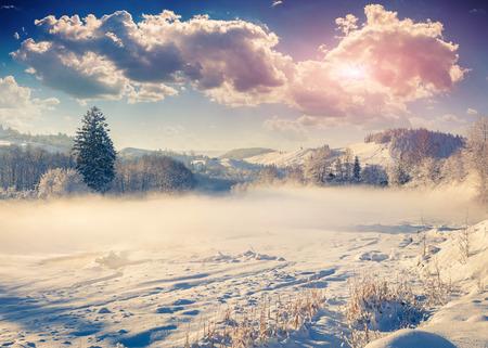 Beautiful winter landscape in the mountain village. Retro style. photo