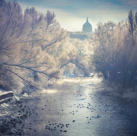 Beautiful winter landscape in the city park. Retro style. photo