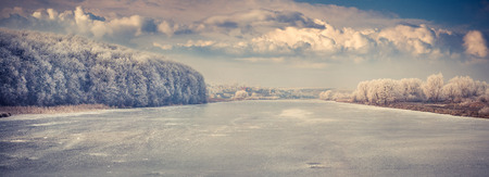 Panorama of the frozen river. photo