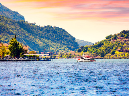 View of the Lake Iseo, colorful summer morning. Region Lombardy, Province Brescia (BS) in Iseo Lake. Italy, Europe.