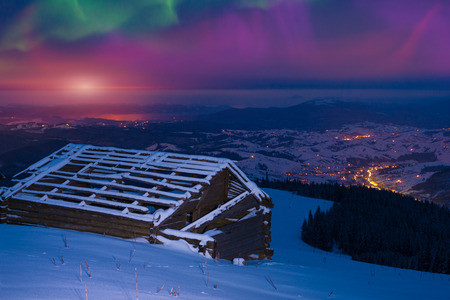 ionosphere: Northern lights in the winter mountains