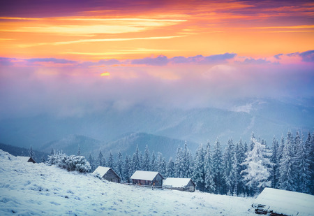 fairytale background: Colorful winter sunrise in the  fogyy mountains.