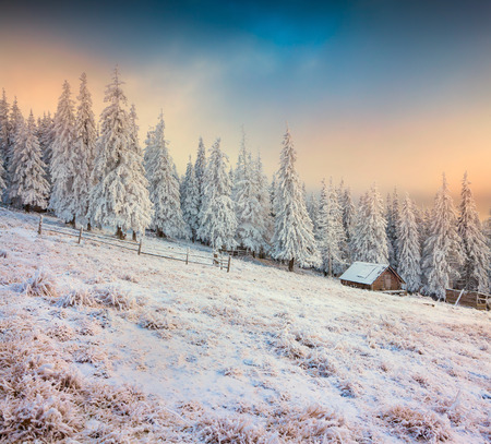 Old farm in the mountains. Colorful winter morning. Retro style.