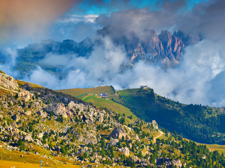 odle: Foggy sunny morning on the Val Gardena valley. View of the Sella towers from Sella pass. National Park Odle Geisler. Dolomites, South Tyrol. Italy, Europe. Stock Photo