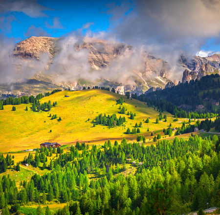sella: Foggy summer morning in Italy Alps, view from Sella pass, Dolomites, Europe. Stock Photo