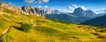 Panorama of the Sassolungo (Langkofel) and Sella group, valley Gardena. National Park Dolomites, South Tyrol. Location Ortisei, S. Cristina and Selva, Italy, Europe. photo