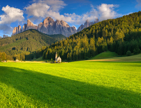 odle: Countryside view of the St. Magdalena or Santa Maddalena in the National Park Puez Odle or Geisler summits. Dolomites, South Tyrol. Location Bolzano, Italy, Europe. Stock Photo