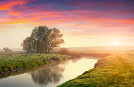 Colorful summer sunrise on the river photo
