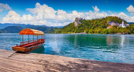 karavanke: Lake Bled (Blejsko jezero) is a glacial lake in the Julian Alps in northwestern Slovenia, where it adjoins the town of Bled.
