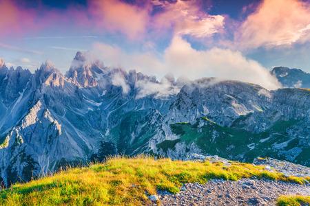 Colorful summer sunrise of the Cadini di Misurina range in National Park Tre Cime di Lavaredo. Dolomites, South Tyrol. Location Auronzo, Italy, Europe. photo