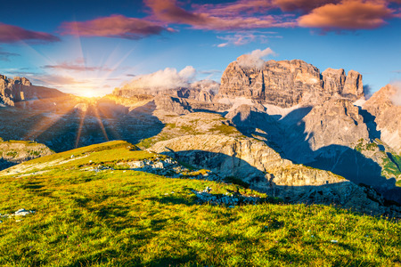 Colorful summer sunset on the Paternkofel mountain range in National Park Tre Cime di Lavaredo. Dolomites, South Tyrol. Location Auronzo, Italy, Europe
