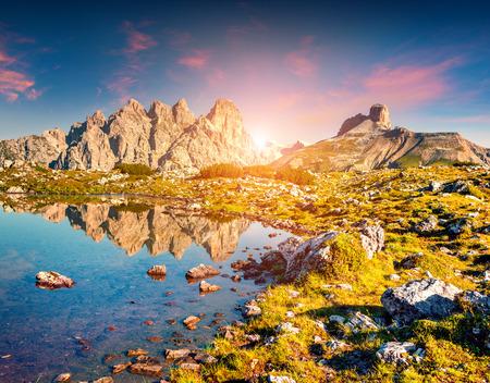 Colorful summer sunrise on the Lago Rienza - Ursprung in National Park Tre Cime di Lavaredo. Dolomites, South Tyrol. Location Auronzo, Italy, Europe. photo