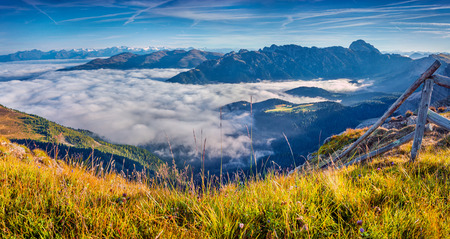 odle: Panorama of the foggy valley. National Park Odle (Geisler). Dolomites, South Tyrol. Location Ortisei, Italy, Europe.