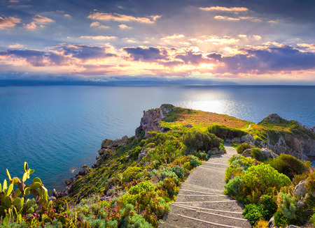 Colorful spring sunset on the cape Milazzo, nature reserve Piscina di Venere, Sicily, Italy, Tyrrhenian sea, Europe.