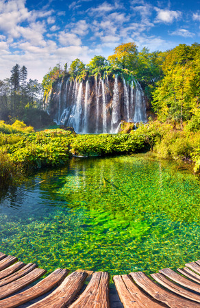 Landscape of a beautiful rock with a waterfall under the blue sky. Plitvice Lakes National Park is the oldest national park in Southeast Europe and the largest national park in Croatia.