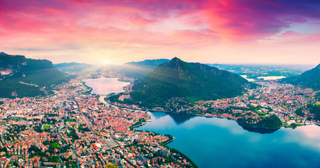 Colorful summer sunrise on the city and lake Lecco. Alps, Italy, Europe. photo