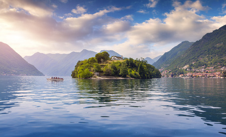 island: Foggy spring morning on the island Comacina on Lake Como. Alps, Italy.