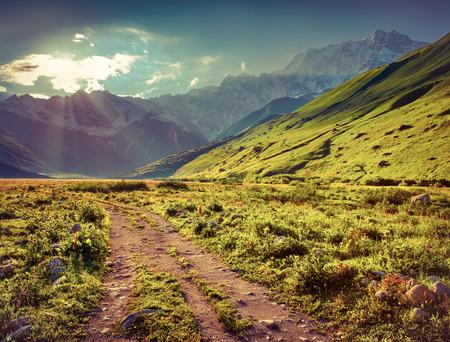 ushguli: The main Caucasian ridge, Shkhara mountain. The view from the Ushguli village. Georgia, Upper Svaneti. Retro style.