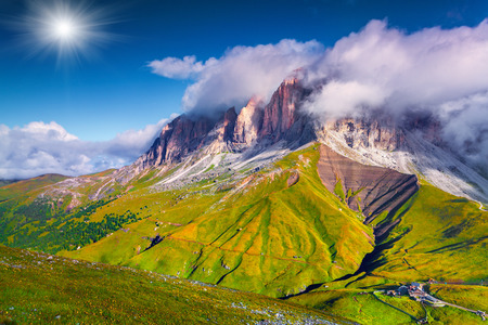 selva: Colorful summer morning on the Sassolungo (Langkofel). View from the Sella pass. National Park Dolomites, South Tyrol. Location Ortisei, S. Cristina and Selva, Italy, Europe. Stock Photo