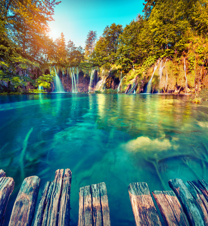 waterfall with sky: Colorful summer morning in the Plitvice Lakes National Park. Croatia. Europe. Lomography stylization and instagram toning effect.